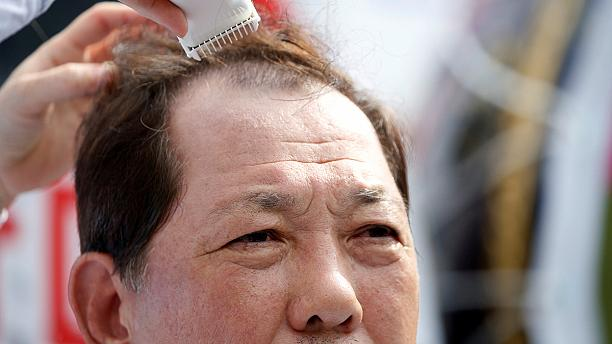 Shaving heads, another way to protest in South Korea