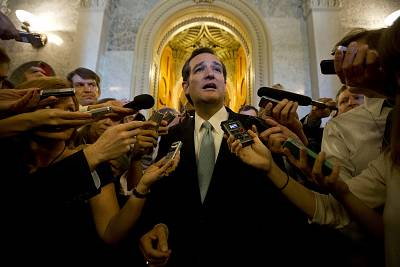"""U.S. Senator Ted Cruz (R-TX) speaks to the press after leaving the U.S. Senate Chamber after a marathon attack on """"Obamacare,"""" at the U.S. Capitol on September 25, 2013."""
