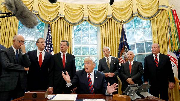 Image: U.S. President Trump talks to reporters during bill signing ceremony
