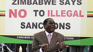 Mugabe jabs 'political' pastors and ambassadors at war veterans' meeting