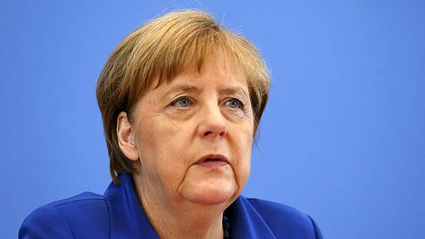 Angela Merkel stands by refugee policy after attacks in Germany