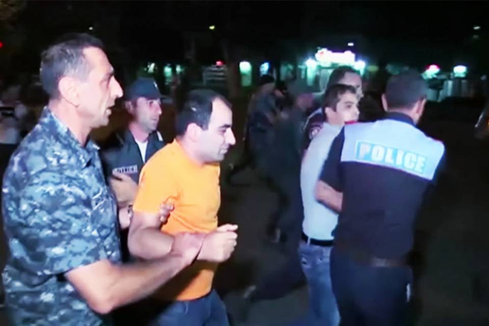 Dozens wounded in further night of clashes at besieged Yerevan police station