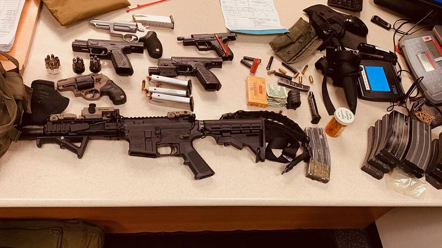 An arsenal of weapons and a bullet-resistant vest were seized after David G