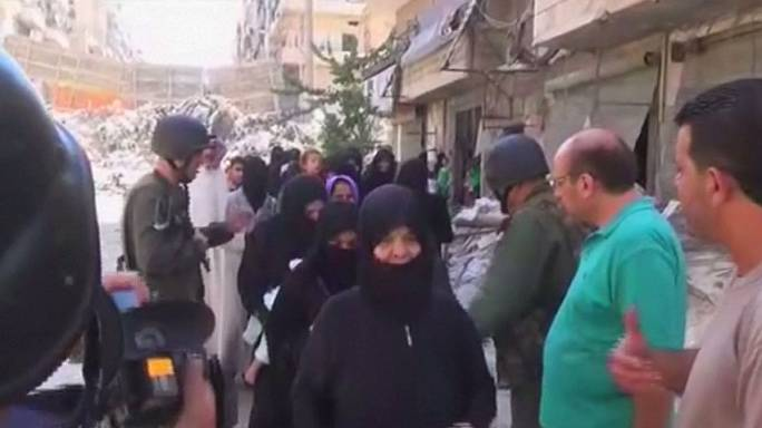 Women and children use 'safe corridors' to escape Aleppo - Syria TV reports