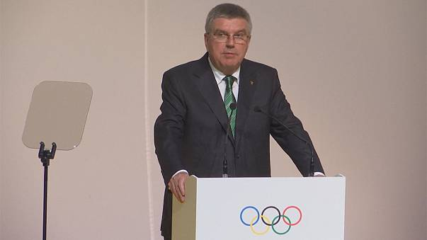Bach defends IOC decision on Russia at 129th Session
