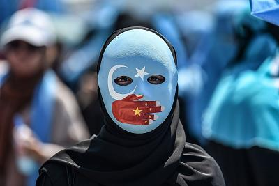 A demonstrator in Istanbul denounces China\'s treatment of ethnic Uighur Muslims.