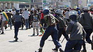 Zimbabwe police disperse protesters with water canon and tear gas