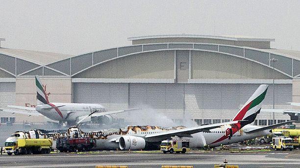 Passengers dramatic escape as plane bursts into flames at Dubai airport