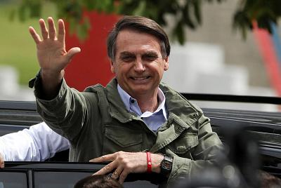 Jair Bolsonaro gestures at a polling station in Rio de Janeiro, Brazil, on Sunday.