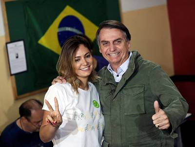 Jair Bolsonaro and his wife Michelle pose as they arrive to cast their votes in Rio de Janeiro, Brazil, on Sunday.