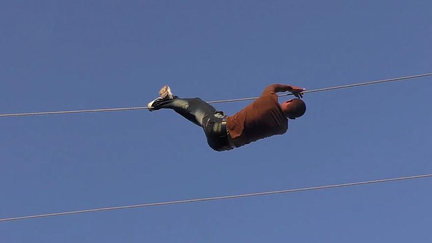 Villagers in Syria take broken power lines into their own hands...literally