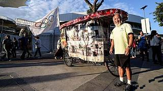 60-year-old Chinese farmer cycles around the world to Rio