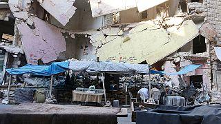 Lourds combats pour une Alep en ruines