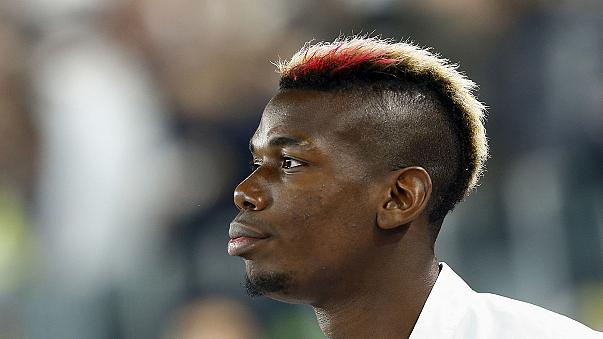 French footballer Paul Pogba signs for Man Utd for 'world record fee'
