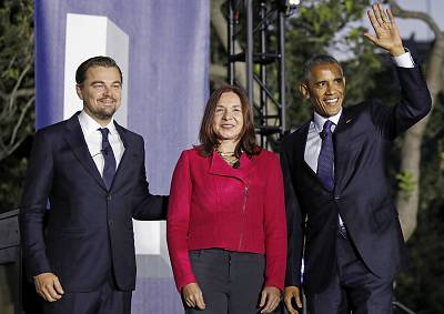 President Barack Obama, right, arrives with actor Leonardo DiCaprio, left, and Dr. Katharine Hayhoe, to talk about climate change as part of the White House South by South Lawn event on the South Lawn of the White House in Washington on Oct. 3, 2016.