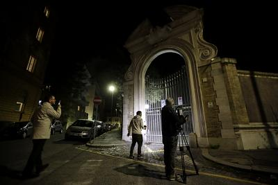 Reporters gather outside the Vatican Embassy to Italy overnight.
