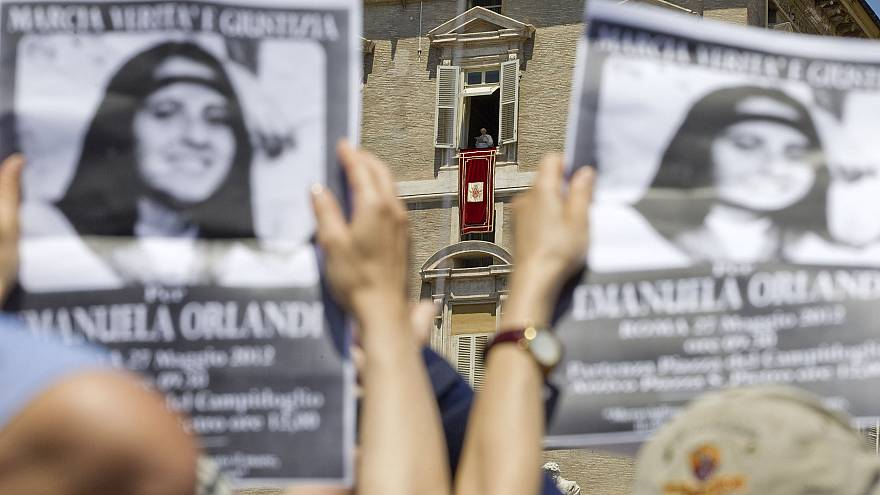 Image: Demonstrators hold pictures of Emanuela Orlandi, as Pope Benedict XV