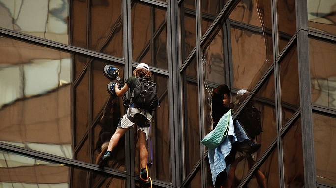 Man climbing Trump Tower in New York using suction pads is captured by police