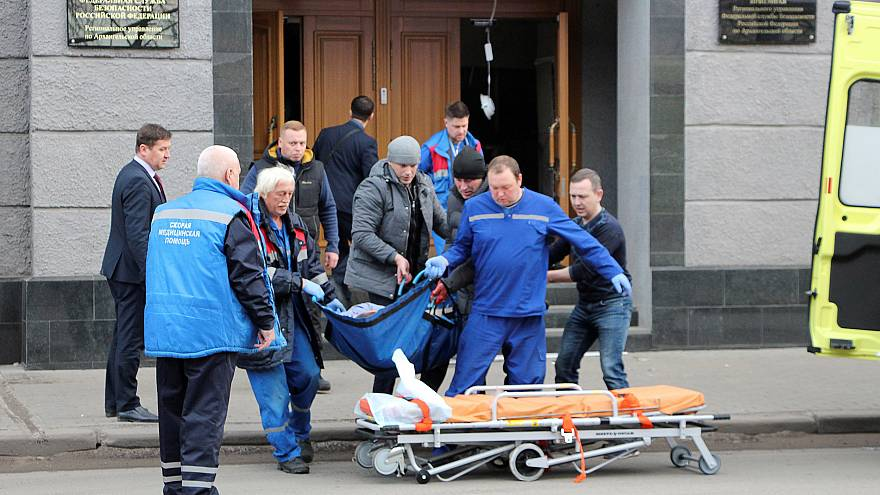 Image: Medics work at the site of an explosion at an office of Russia's Fed
