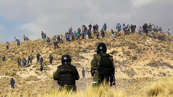 Los mineros bolivianos ofrecen una tregua tras días de protestas contra una reforma liberal del Gobierno