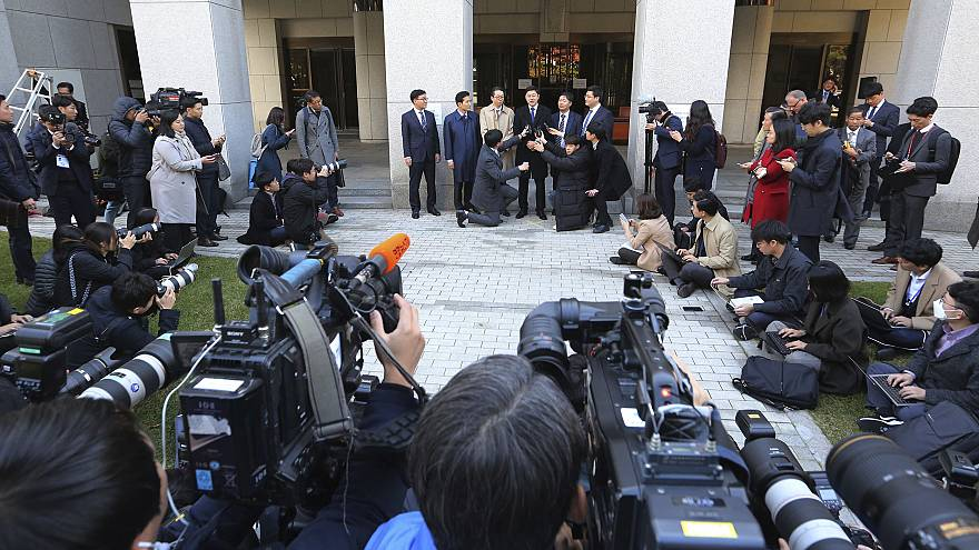 Image: Oh Seung-hun, top center, speaks to the media after the verdict