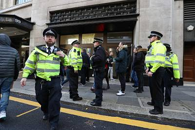 Police officers respond at the office building housing Sony Music\'s offices in London on Nov. 2, 2018 after after two people were stabbed.