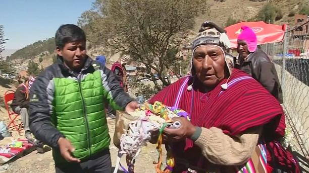 Bolivia: believers of the Virgin of Urkupina break rocks to ask for favours during a religious procession