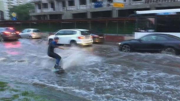 Moscow: wakeboarders take to the streets following torrential rain
