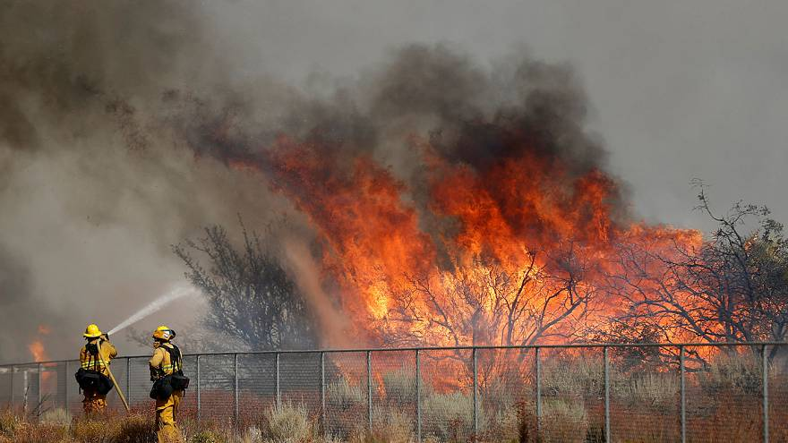 Thousands of homes under threat from southern California wildfires.