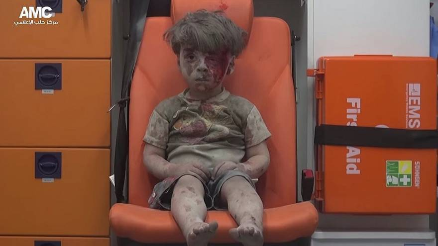 Video of bloodied Syrian boy captures horror of Aleppo
