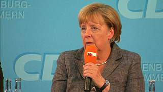 Angela Merkel sale en defensa de los refugiados