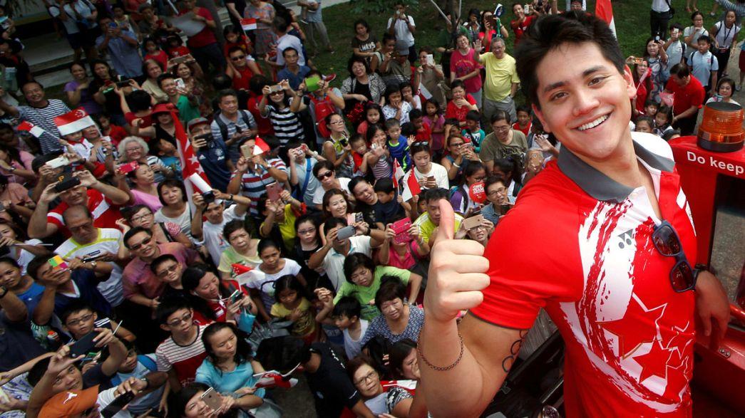 Чемпионский прием Джозефа Скулинга в Сингапуре