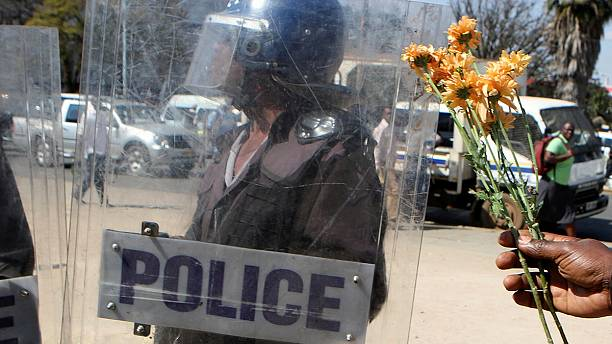 Zimbabwe police beat up activist who offers them flowers
