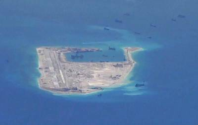 Chinese dredging vessels in the waters around Fiery Cross Reef in the South China Sea in 2015.