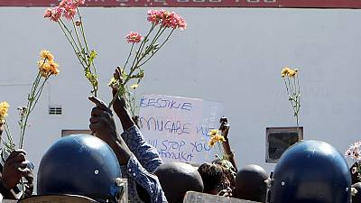Zimbabwe police show no mercy to activist who offered them flowers