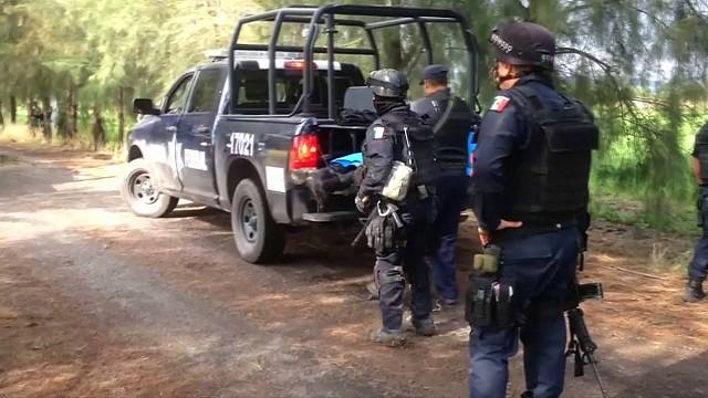 """На мексиканских полицейских """"повесили"""" 22 убийства"""