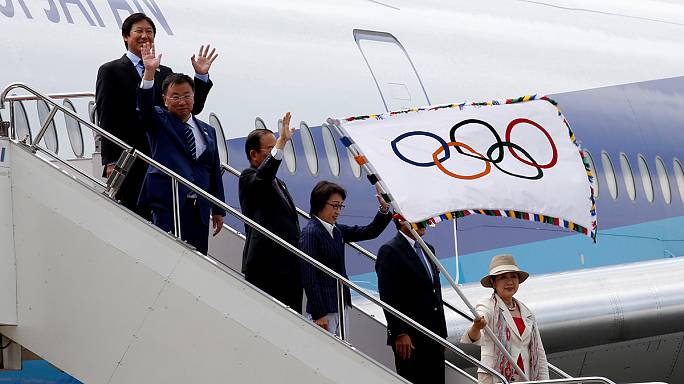 The Olympic flag arrives in Tokyo