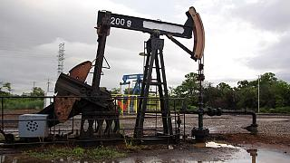 Hopes of a production freeze dim, pulling down oil prices