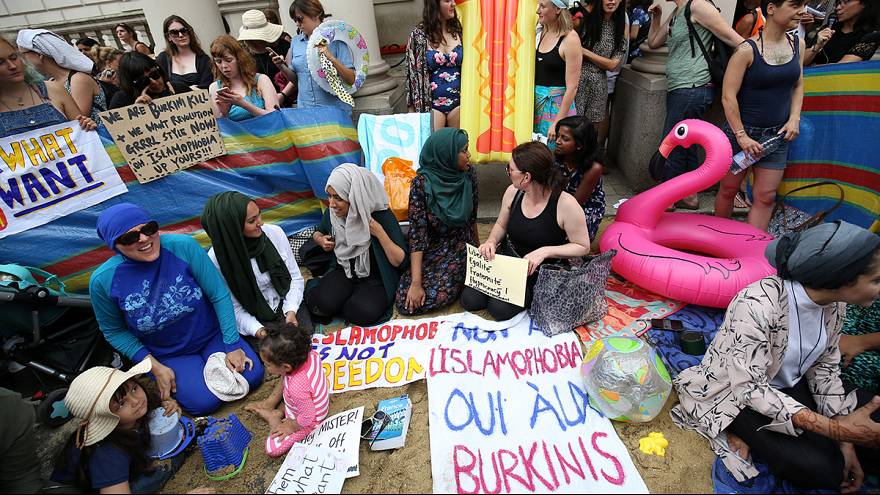Burkini ban in parts of France provokes beach-themed protest in London