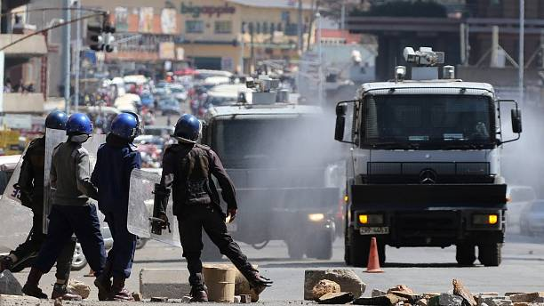 Zimbabwe minister says illegal protesters will face full wrath of the law