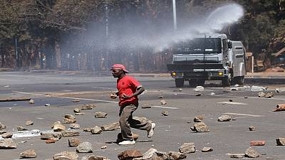 Zimbabwean police fire tear gas to disperse demonstrators
