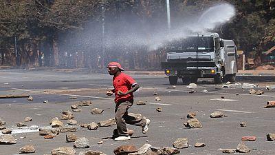 Zimbabwean police fire tear gas to disperse demonstrators