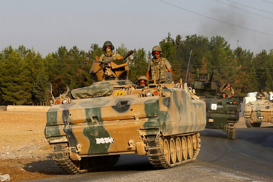 Turkish PM says Syria border must be cleansed of threats