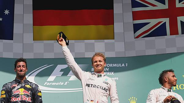 Rosberg cruises to maiden Belgian GP win as Hamilton battles from the back to finish third