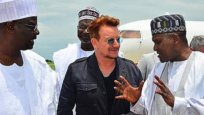 [Photos] Dangote and Bono visit displaced people in Borno State