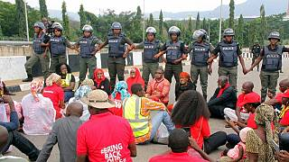 [Photos] Chibok Girls activists march to Buhari with lips sealed, blocked by police