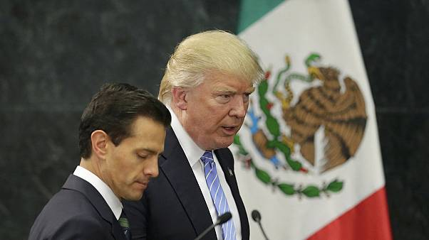 Trump defends call for Mexico border wall - Pena Nieto refuses to pay