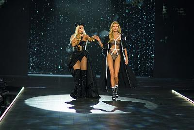 Rita Ora (left) performs on stage as model Stella Maxwell shows off another beautiful look.