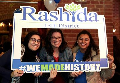 Rashida Tlaib (center) celebrates at her midterm election night party in Detroit, Michigan.