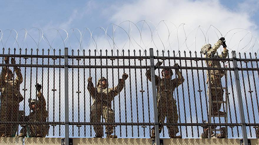 Image: FILE PHOTO: FILE PHOTO: U.S. Army soldiers install a razor wire fenc